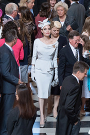 Angelina Jolie looked perfectly refined in a pale gray Ralph & Russo Couture cocktail dress with a draped neckline and ruffle detailing at the Service of Commemoration and Dedication in London.