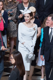 Angelina Jolie paired a silver Ralph & Russo clutch with a pale gray cocktail dress for the Service of Commemoration and Dedication in London.