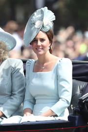 Kate Middleton accessorized with a sculptural hat by Juliette Botterill to match her ice-blue dress at the Trooping the Colour.