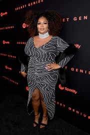 Lizzo paired her dress with simple black ankle-strap sandals.