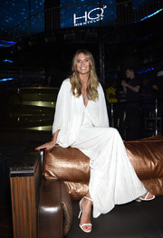 Heidi Klum teamed white Jimmy Choos with a flowing dress for a dinner at Ocean Resort Casino.