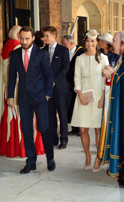 Pippa Middleton channeled regality in a cream-colored evening coat during the christening of Prince George.