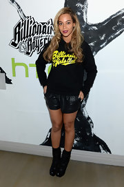 Beyonce paired cool leather shorty shorts with a hoodie for a relaxed and casual look.
