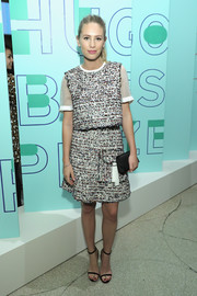 Dylan Penn was relaxed yet chic in a loose tweed top with sheer white sleeves at the Hugo Boss Prize event.