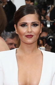 Cheryl Cole added some serious drama to her look with smoldering shadow swept across her upper lids. A metallic shade of bronze lined her lower lids.