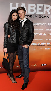 Sila Sahin oozed style in a black leather military jacket.