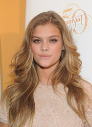Nina Agdal attended the SI Swimsuit 50 Years of Swim event wearing a goddess-worthy feathered flip.
