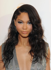 Chanel Iman went for a radiant beauty look with bright blue-silver eyeshadow.
