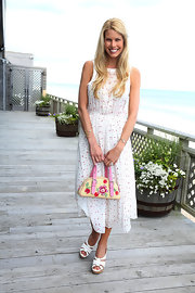 Beth Stern looked lovely in a white and pink printed day dress.