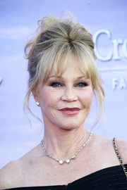 Melanie Griffith styled her hair into a messy-glam updo for the Hallmark Channel Summer TCA Press Tour.