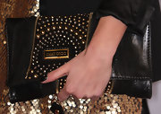 Nikki showed off her edgy side with a gold-and-silver studded leather clutch.