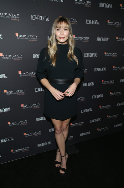 Elizabeth Olsen kept it understated in a dark green mini dress by A.L.C. at the 2018 Hamilton Behind the Camera Awards.