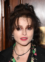 Helena Bonham Carter styled her hair into a messy updo for the opening of 'Hamilton' in London.