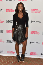 Aja Naomi King spiced up her look with a biker-chic leather skirt.