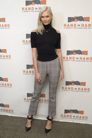 Karlie Kloss teamed her sweater with a pair of glen plaid pants by Sonia Rykiel.