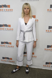 Karolina Kurkova chose a belted white pantsuit with black trim for the Hand in Hand: A Benefit for Hurricane Relief.