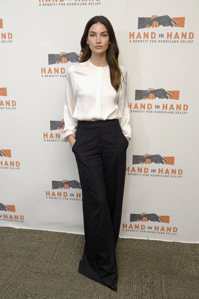Lily Aldridge kept it modest and classy in a long-sleeve white silk blouse at the Hand in Hand: A Benefit for Hurricane Relief.