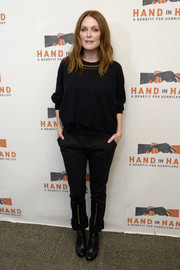 Julianne Moore was casual and edgy in a black Louis Vuitton sweater with an embellished neckline at the Hand in Hand: A Benefit for Hurricane Relief.