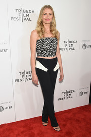 Black Sally LaPointe trousers with contrast pocket flaps sealed off Yvonne Strahovski's look.