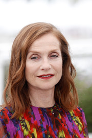 Isabelle Huppert attended the Cannes Film Festival photocall for 'Happy End' wearing a gently wavy 'do.