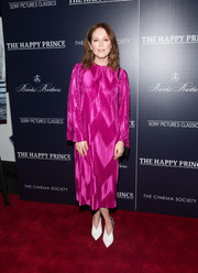 Julianne Moore kept it modest in a loose, long-sleeve fuchsia dress by Givenchy at the New York screening of 'The Happy Prince.'