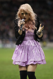 Amelia Lily paired a prim lavender baby doll dress with an edgy sequined jacket while performing in London.