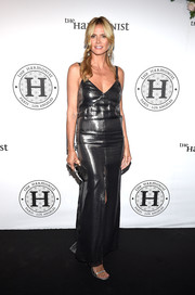 Heidi Klum was all about edgy glamour in a plunging gunmetal lame gown by Saint Laurent at the Harmonist cocktail party.