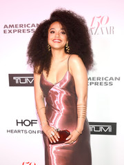 Kiersey Clemons accessorized with a statement gold bracelet at the Harper's Bazaar 150 Most Fashionable Women event.