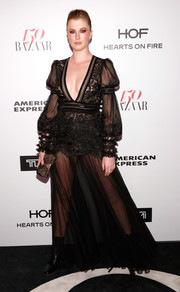 Ireland Baldwin flashed plenty of skin in a plunging, sheer black gown by Tadashi Shoji at the Harper's Bazaar 150 Most Fashionable Women celebration.
