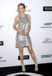 Petra Nemcova kept the shimmer going with a gold Rubeus Milano clutch.