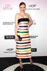 Miranda Kerr paired her vibrant dress with simple black ankle-strap sandals by Jimmy Choo.