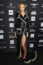 Romee Strijd channeled her inner rock star in a sequined tuxedo gown by Balmain at the 2018 Harper's Bazaar Icons event.