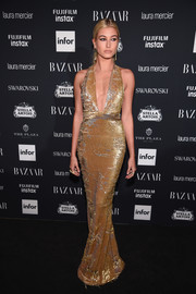 Hailey Baldwin rocked a distressed gold sequin dress by Kaufmanfranco at the Harper's Bazaar Icons event.