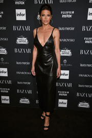 Lisa Rinna looked fierce in a black leather dress with a down-to-there neckline at the Harper's Bazaar Icons event.