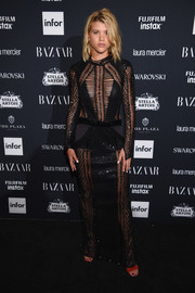 Sofia Richie showed her daring side in a sheer black mesh gown by Julien Macdonald at the Harper's Bazaar Icons event.