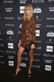 Shanina Shaik went for a leggy look in a leopard-beaded mini dress by Balmain at the Harper's Bazaar Icons event.