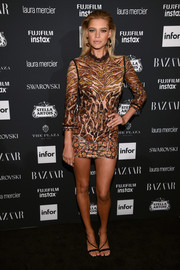 Kelly Rohrbach sizzled in a Roberto Cavalli mini dress, featuring an animal print on a sheer background, at the Harper's Bazaar Icons event.