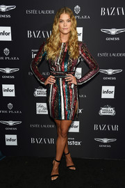 Nina Agdal looked party-ready in a colorful lace and sequin cocktail dress by Zuhair Murad at the 2018 Harper's Bazaar Icons event.