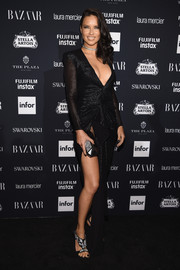 Adriana Lima sealed off her look with a faceted clutch, also by Giuseppe Zanotti.