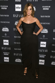 Carine Roitfeld was classic and glam in a strapless black corset gown by Oscar de la Renta at the Harper's Bazaar Icons event.