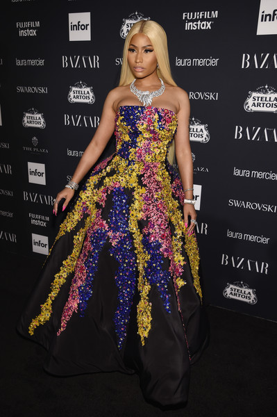 Nicki Minaj was a vision at the Harper's Bazaar Icons event in a strapless Oscar de la Renta ball gown adorned with colorful cascading sequins.