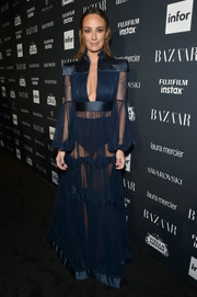 Catt Sadler looked va-va-voom in a sheer, plunging navy gown at the Harper's Bazaar Icons event.
