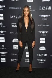 Jasmine Tookes kept it minimal in a black LeiLou by Alex pantsuit at the 2018 Harper's Bazaar Icons event.