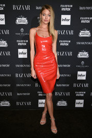 Martha Hunt paired her red-hot dress with silver ankle-strap sandals.
