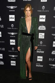 Constance Jablonski was sexy-glam in an emerald Alexandre Vauthier Couture gown with a down-to-the-navel neckline at the 2018 Harper's Bazaar Icons event.