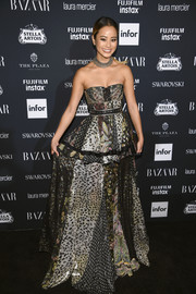 Jamie Chung sported a mishmash of prints with this strapless Robert Cavalli gown at the Harper's Bazaar Icons event.