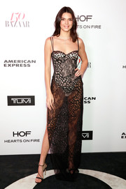 Kendall Jenner kept the sexy vibe going with a pair of strappy black heels by Gianvito Rossi.