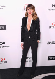 Heidi Klum's black Redemption jacket and pants ensemble at the Harper's Bazaar 150 Most Fashionable Women celebration was a super-sexy way to suit up!