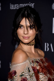 Kendall Jenner went rocker-glam with this disheveled updo at the Harper's Bazaar Icons event.