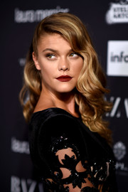 Nina Agdal highlighted her kissers with some matte red lippy.